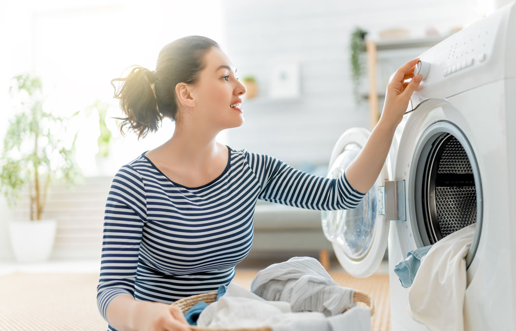 Lady in front of clothes washer